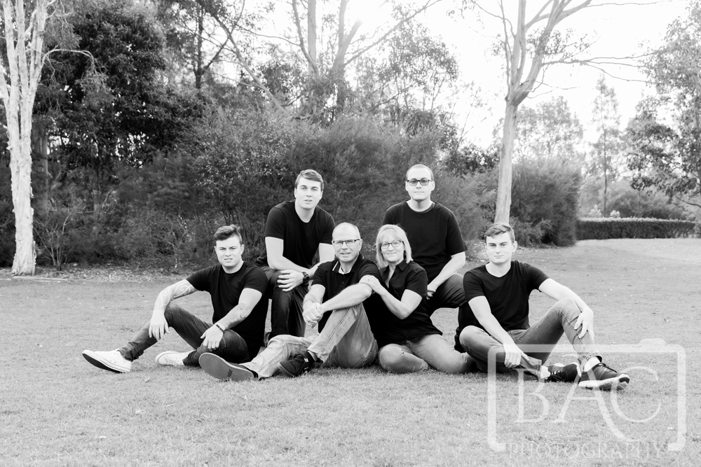 Outdoor Family Portrait with parents and 4 adult boys