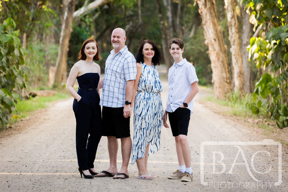 Family portrait on a dirt track at Bribie Island