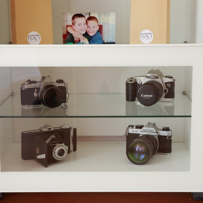 Image of old camera bodies on a shelf