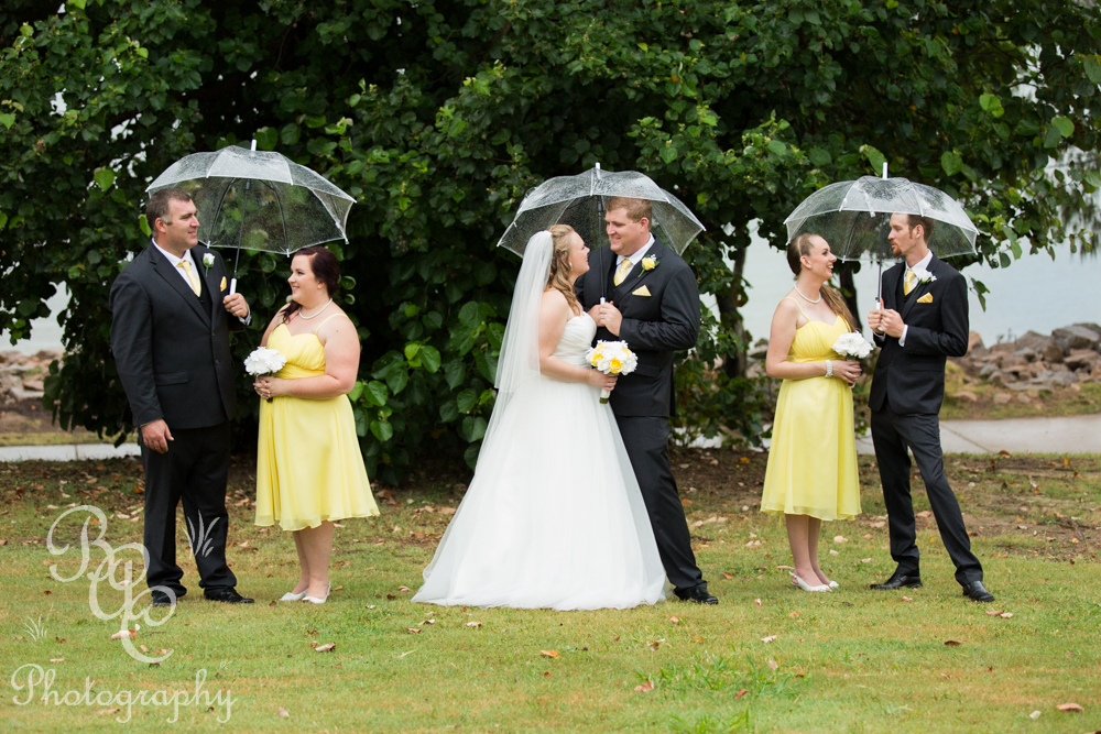 Wedding portrait in the park under umbrellas