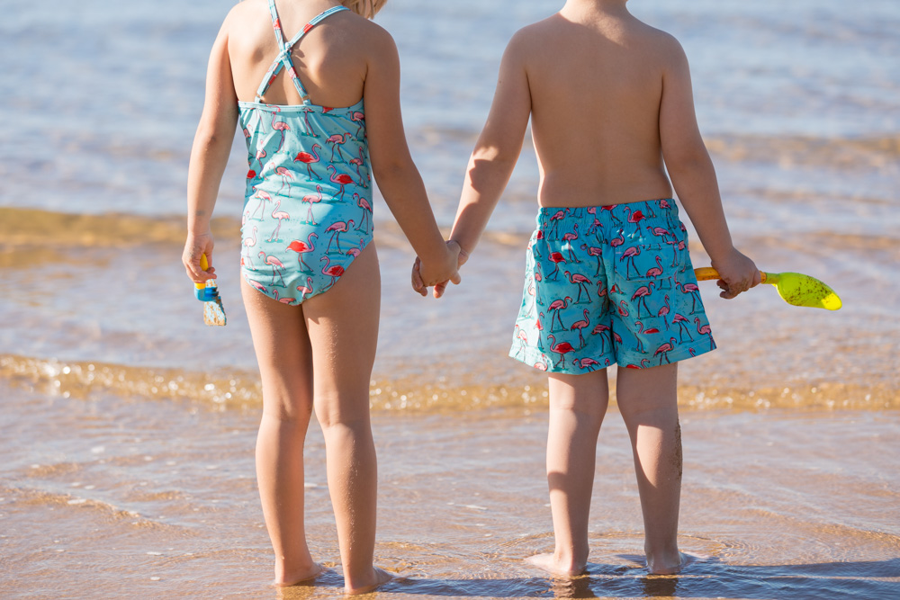 Commercial Portrait Childrens swimwear young kids holding hands