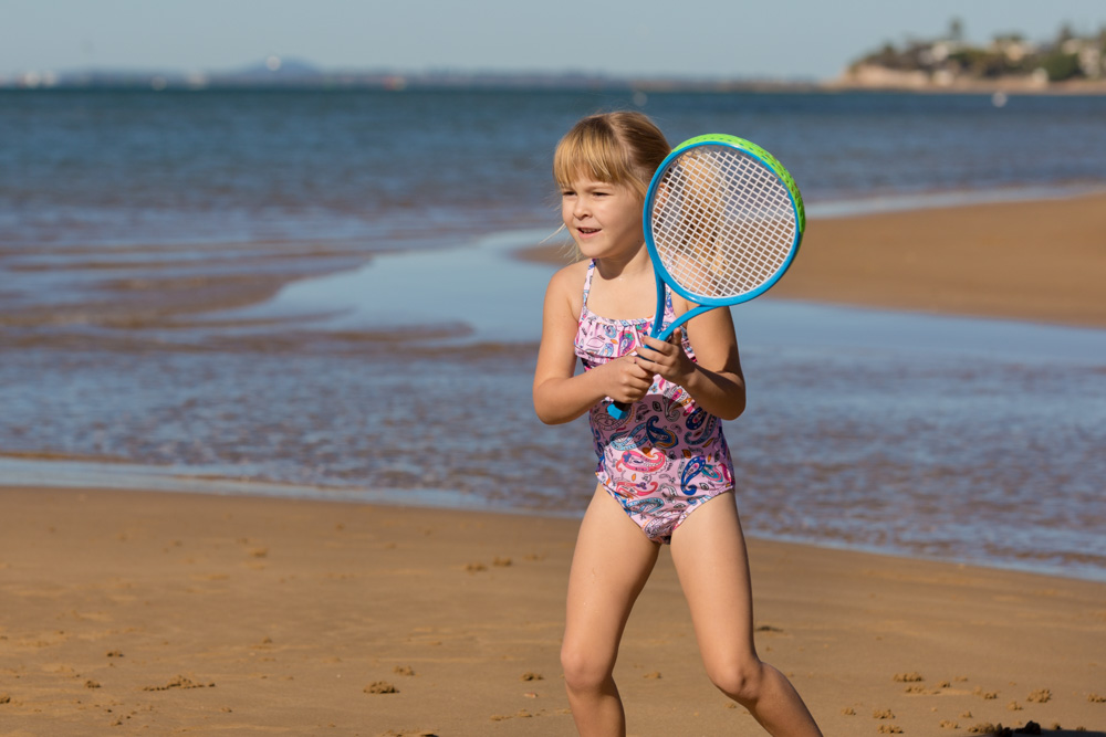Commercial Portrait Childrens swimwear At the beach playing
