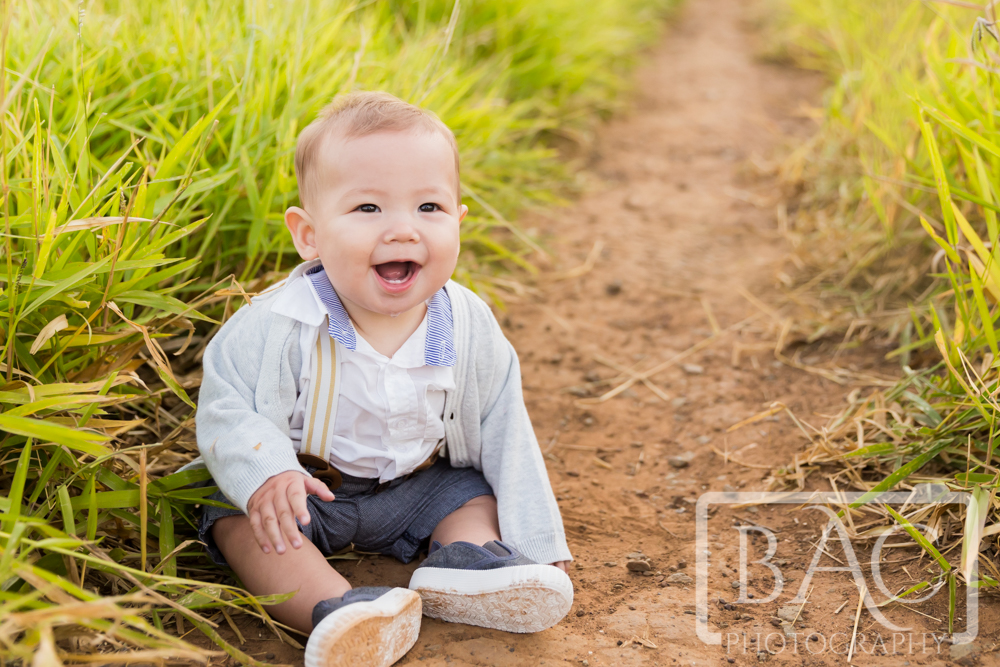 Childrens portrait of little boy in long grass