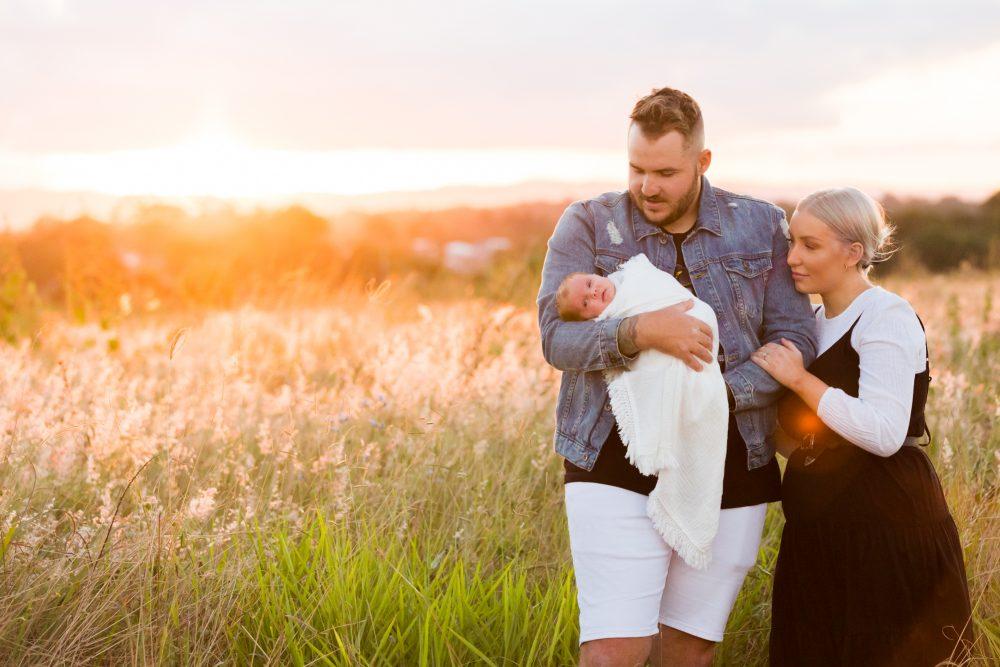 newborn outdoor portrait long grass sunset