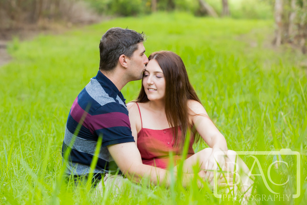 Couples portrait in the long grass