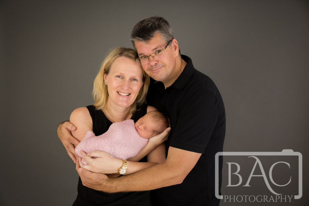 newborn baby girl portrait with parents
