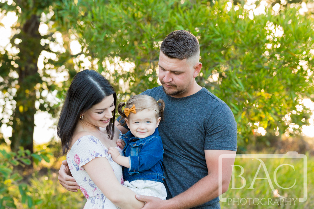 Family of 3 outdoor portrait