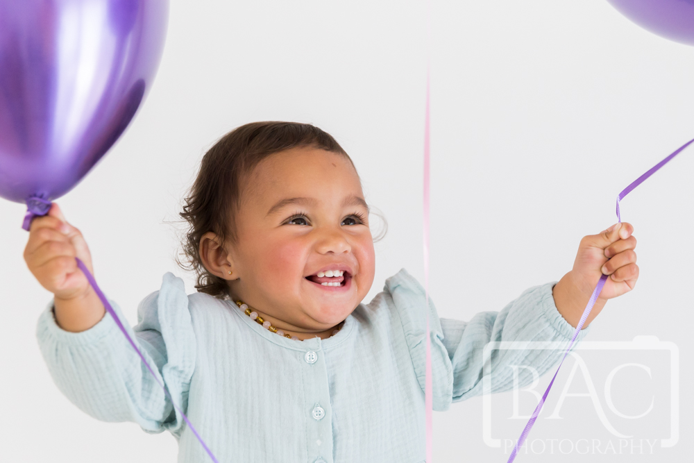 Studio portrait of little girl with balloon