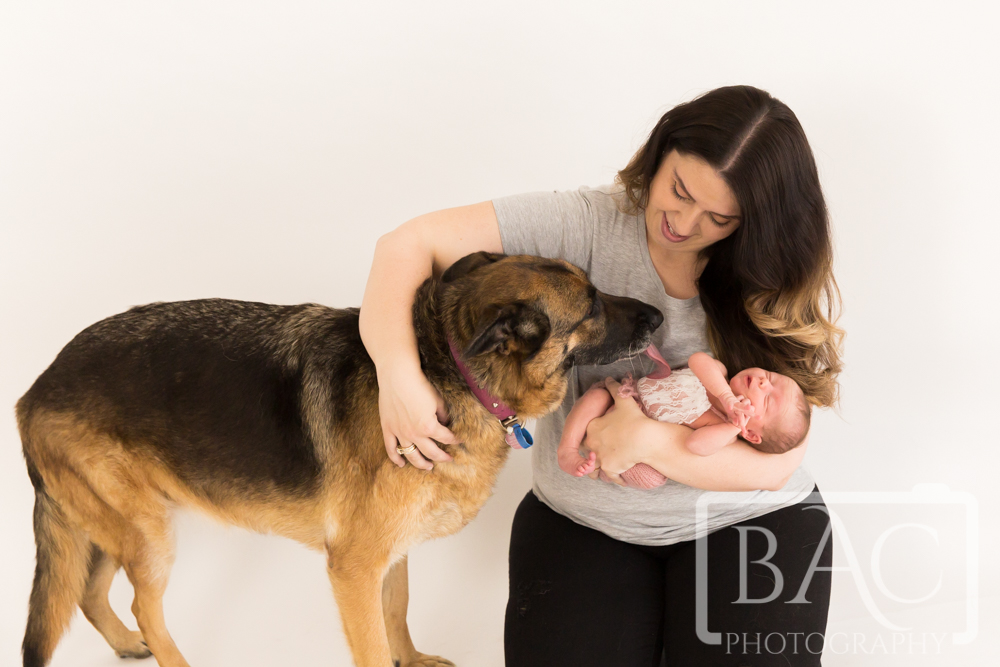 Mum with newborn baby girl and Dog