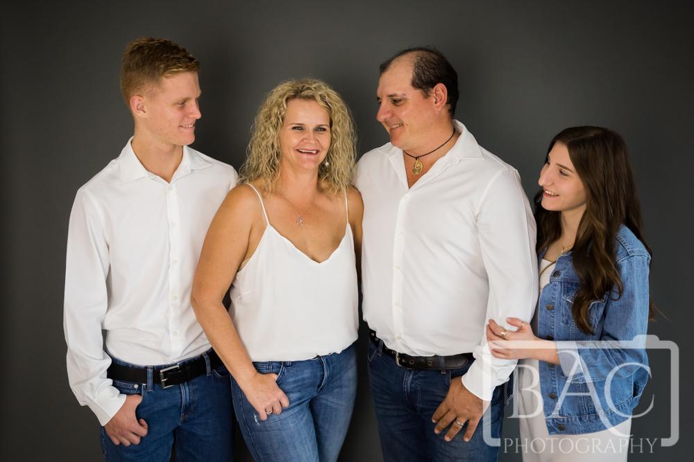Candid studio family portrait