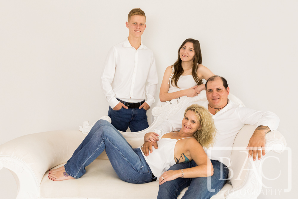 Families on the couch studio portrait