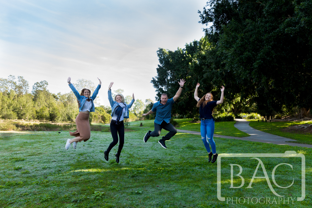 Jumping outdoor family portrait