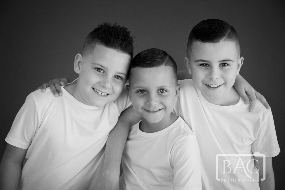 Three brothers sibling portrait
