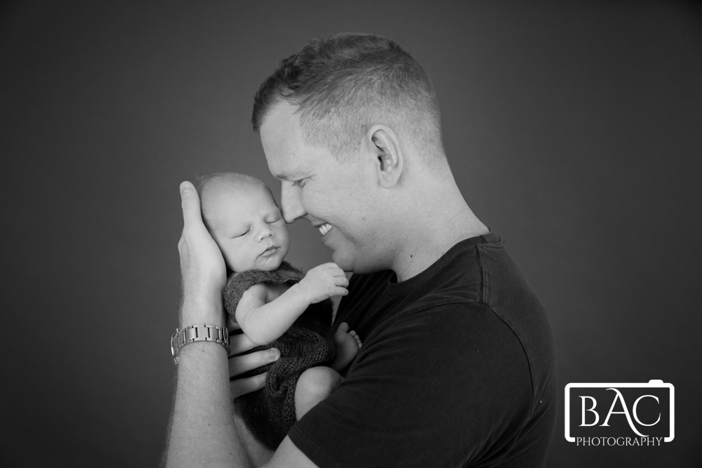 newborn portrait dad and son