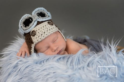 newborn portrait with aviator beanie