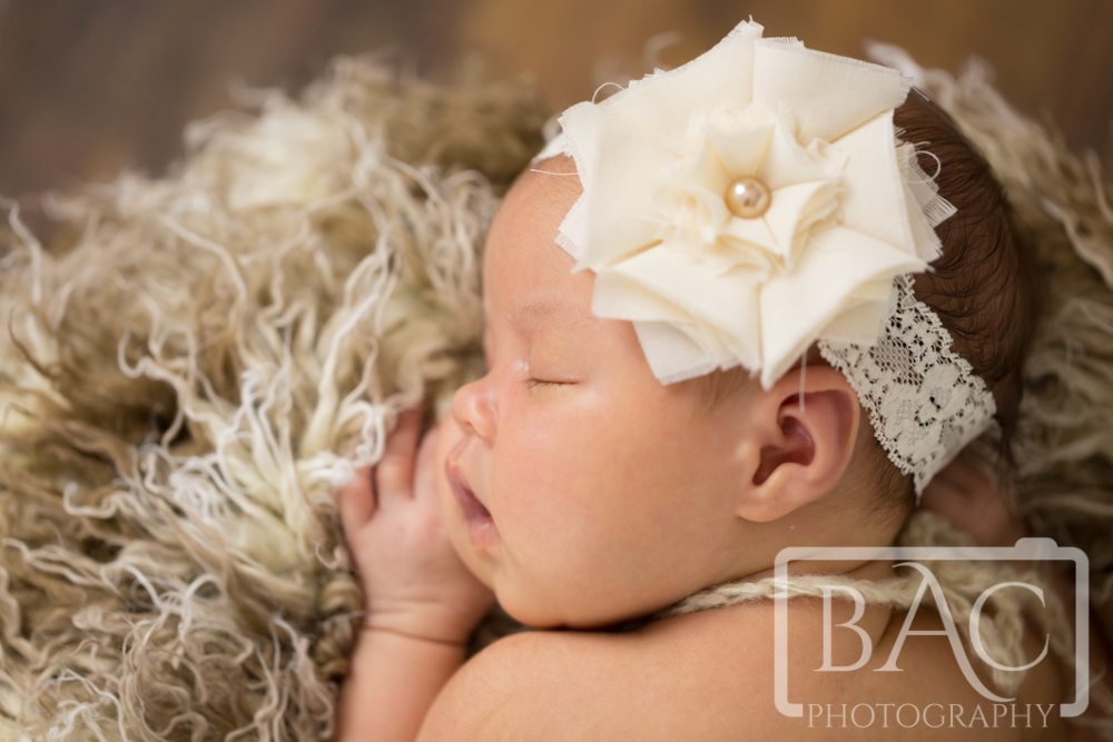 Beautiful newborn baby girl close up