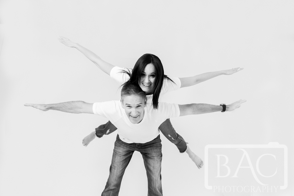 Fun flying couples portrait