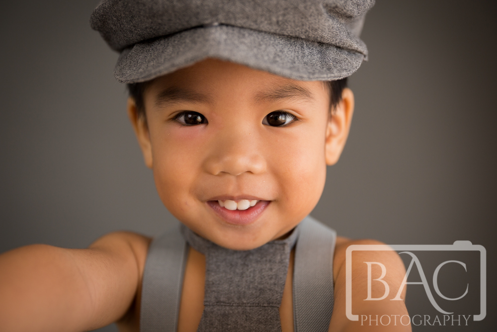 Boys portrait with hat suspenders and tie