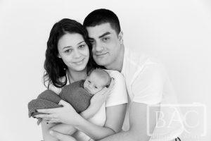 Mum and Dad holding newborn baby boy