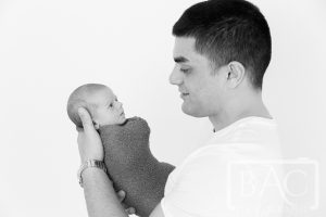 Dad holding newborn baby boy