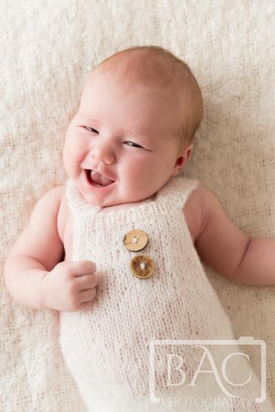 newborn baby girl with big smile