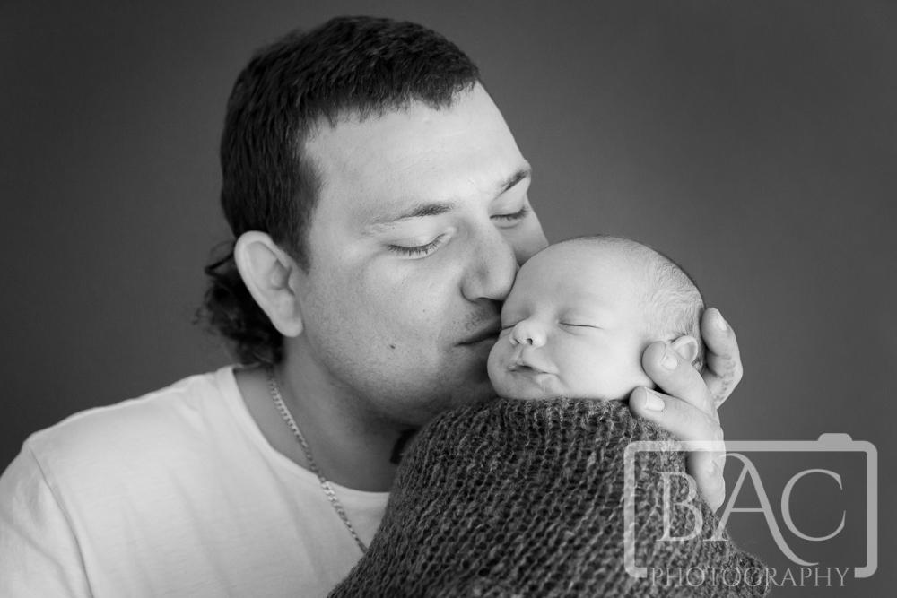 Father and son newborn portrait