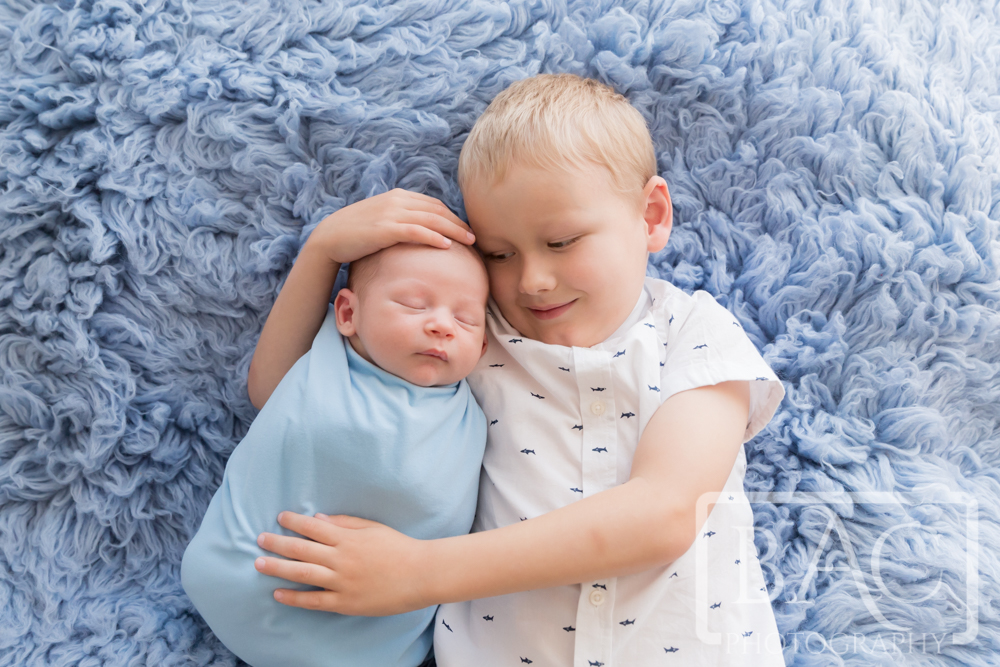 Newborn portrait with big brother