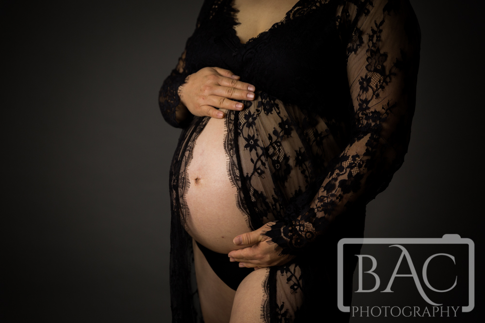 Maternity portrait with black lace gown