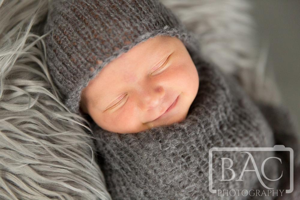 Newborn portrait smiling
