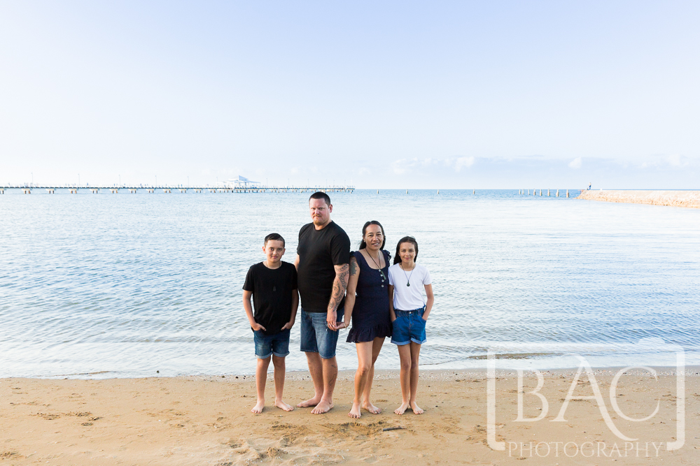 Outdoor family portrait on the beach at Shroncliffe