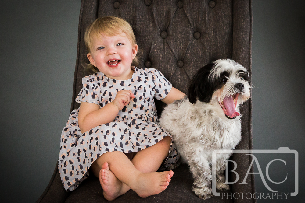 Little girl studio portrait with her dog