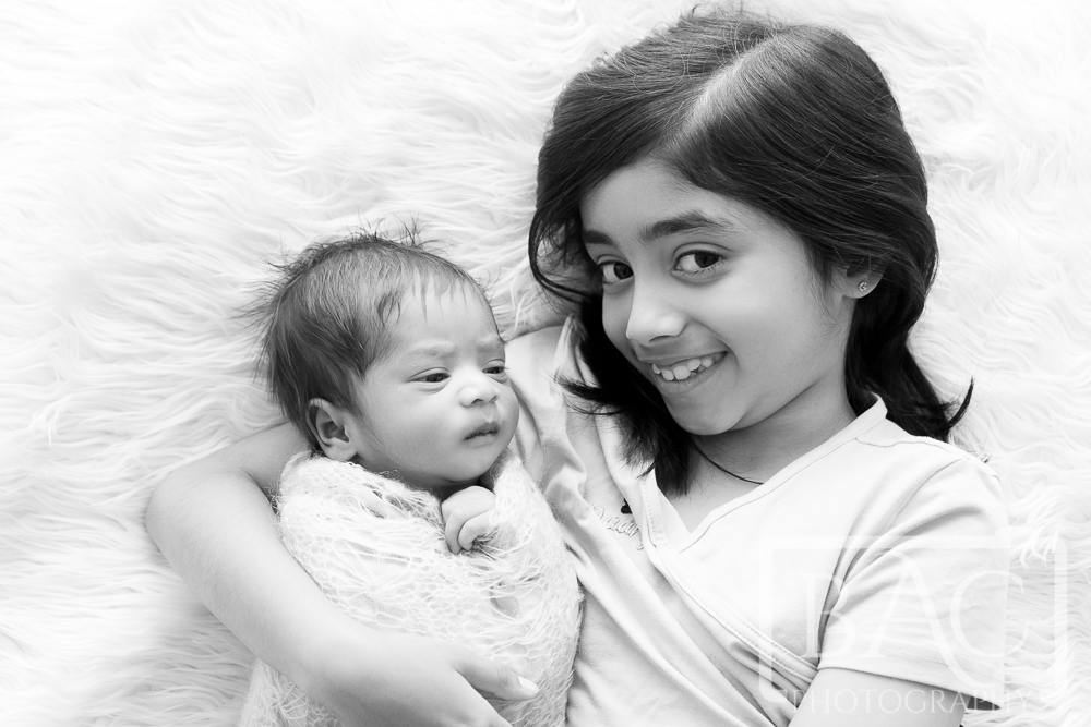 Newborn portrait with sister