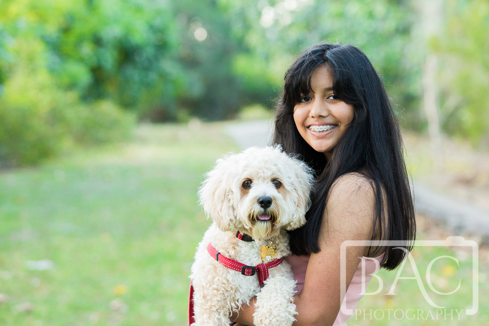 Girl and dog portrait outdoor