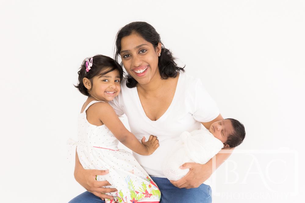 mother and daughters portrait in studio