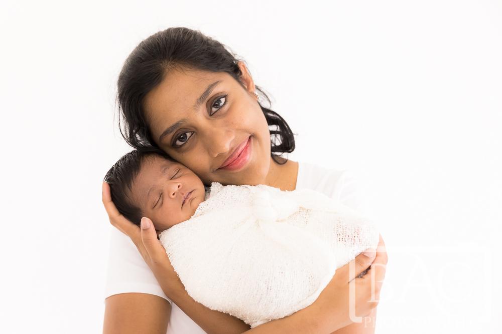mother and newborn portrait in studio
