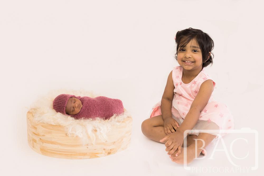newborn and sister portrait in studio
