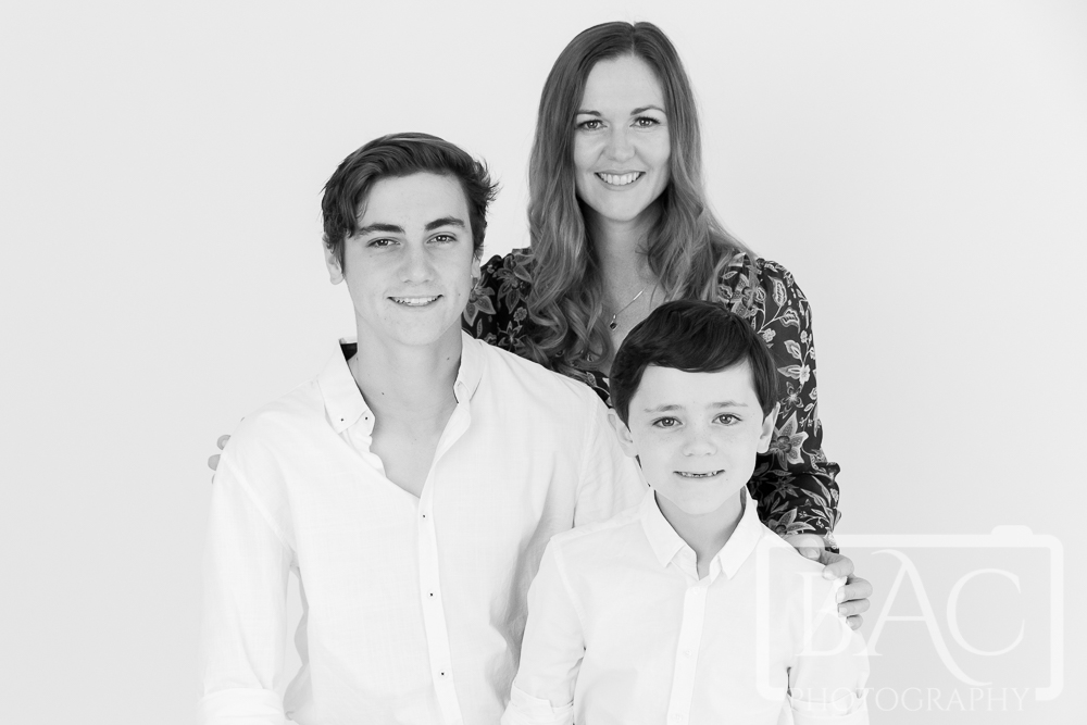 Mother and sons black and white portrait in studio