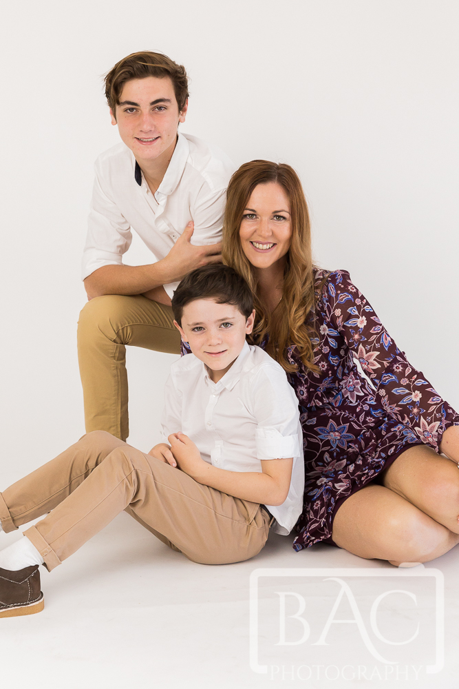 Mother and sons portrait in studio
