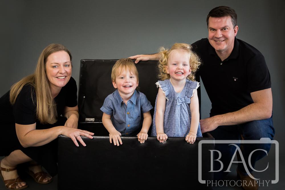 family portrait kids in chest