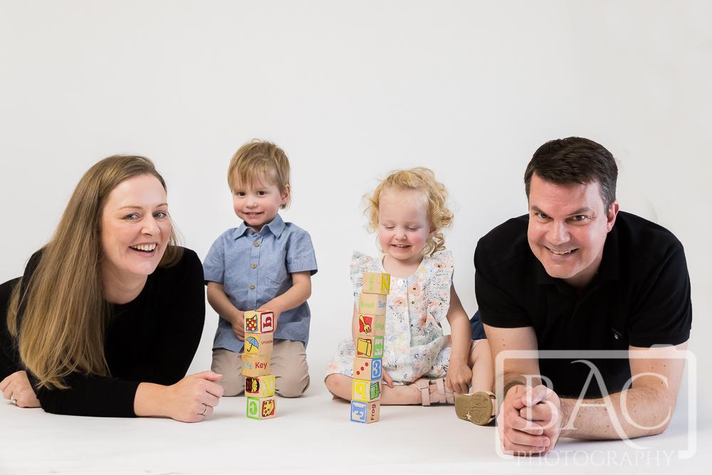 fun family portrait in studio