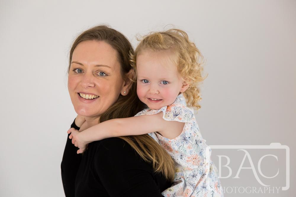 mother and daughter portrait in studio