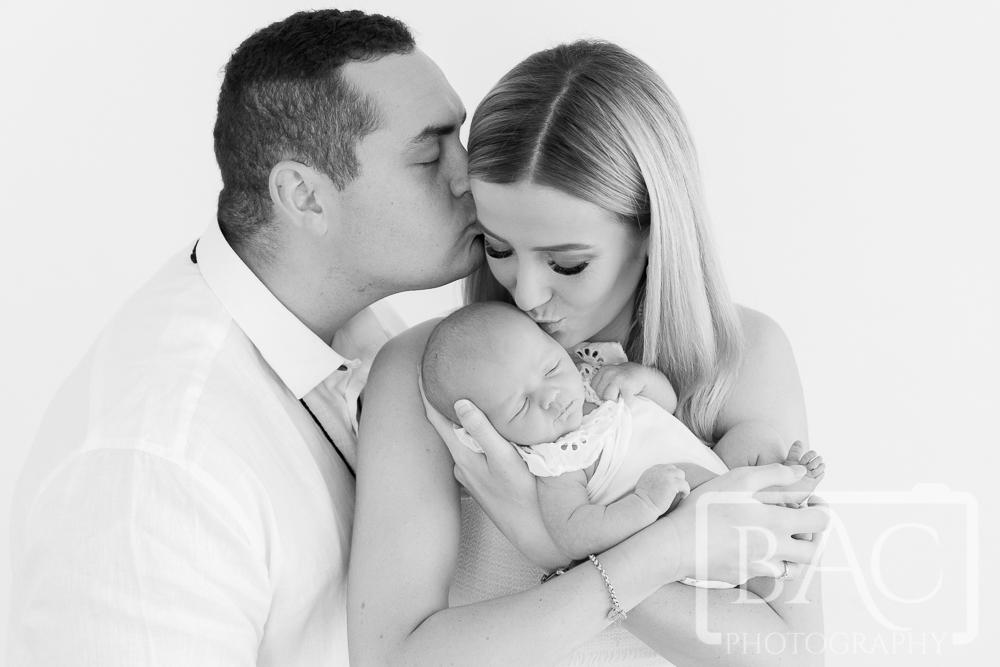 Newborn and family portrait in studio