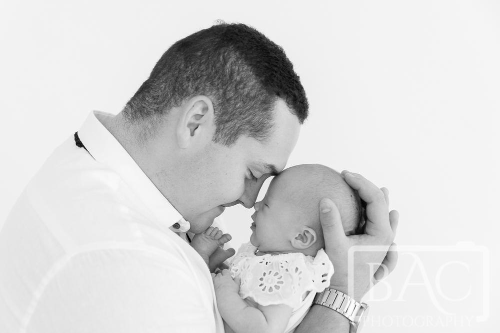 newborn and dad studio portrait