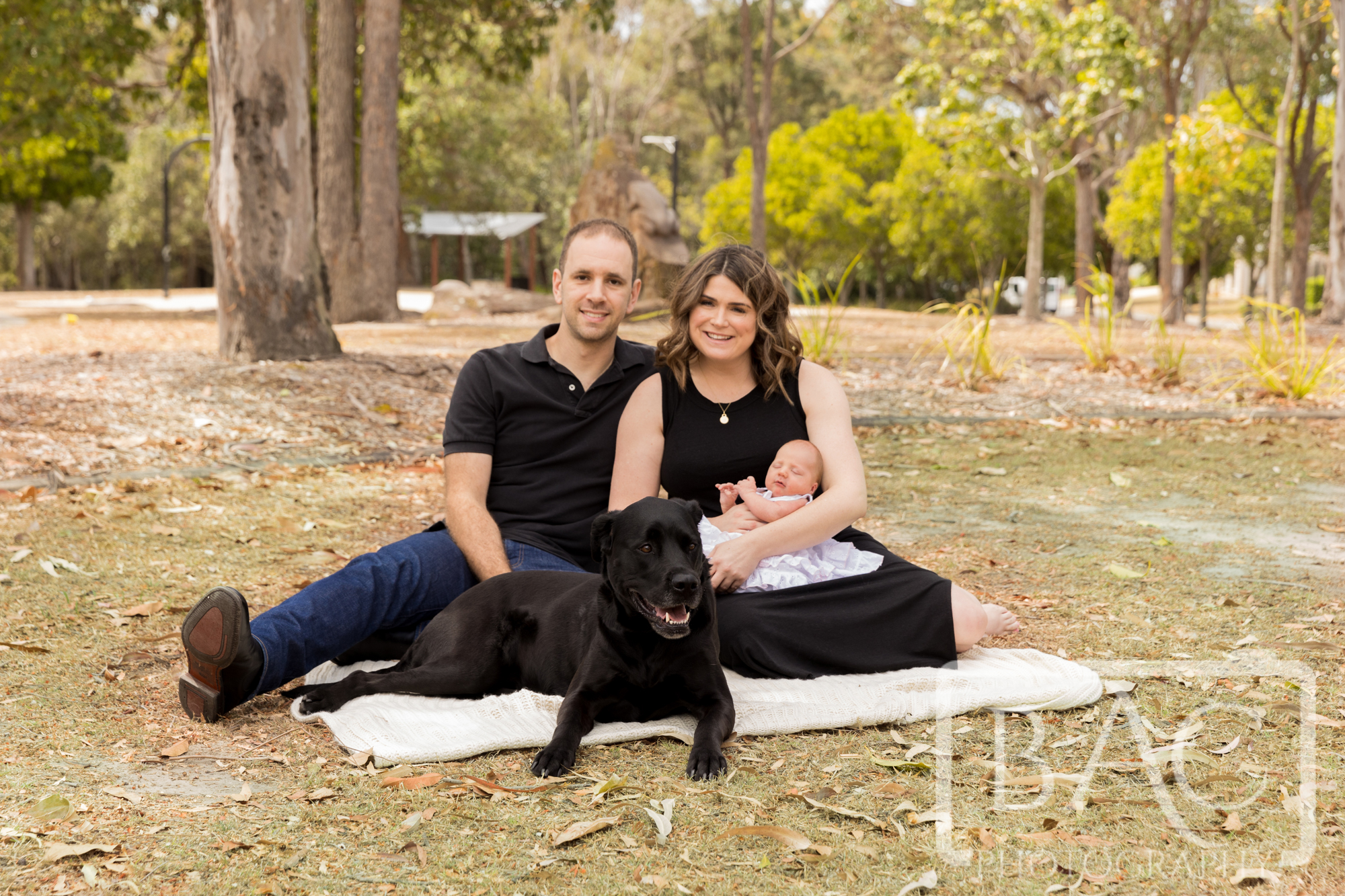 family newborn portrait in the park with dog