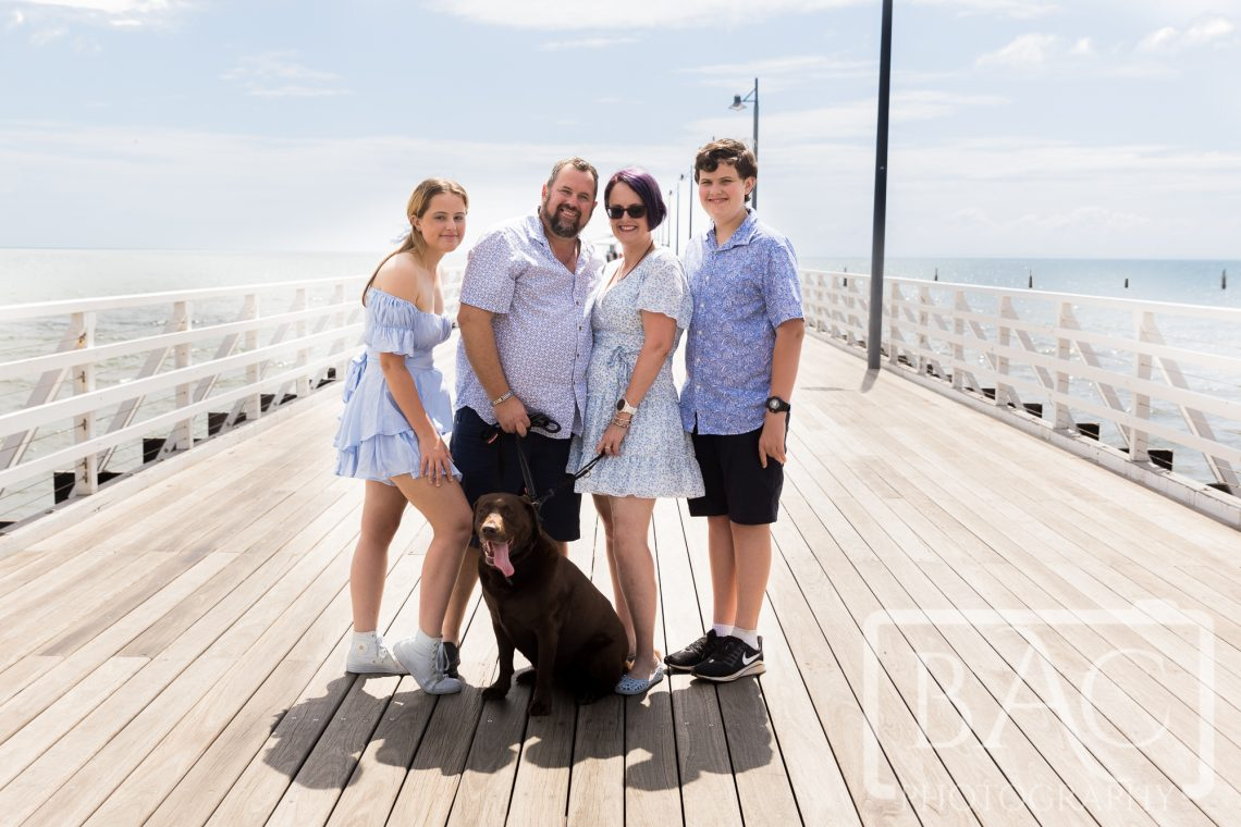 family portrait with dog on jetty