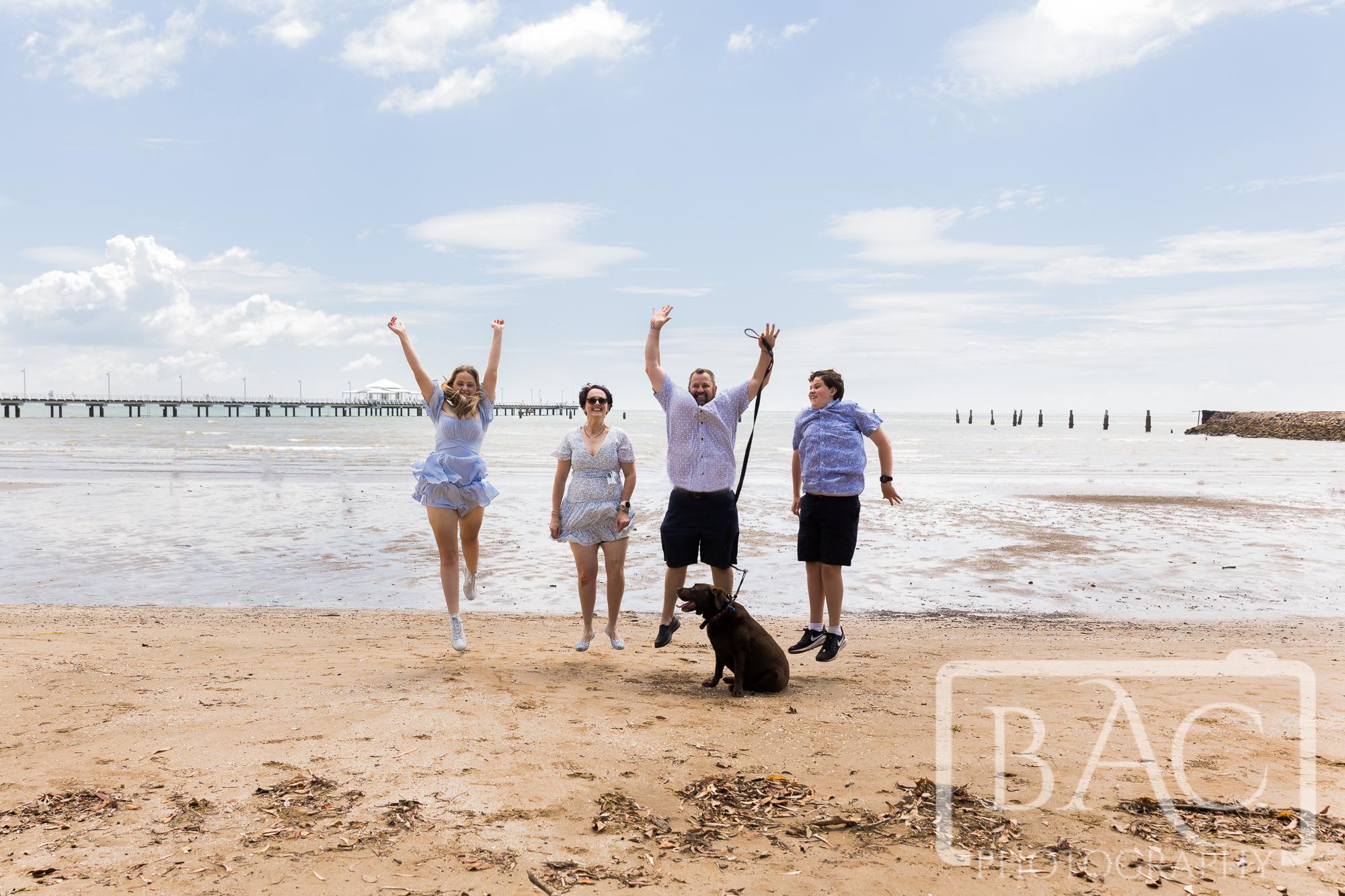 fun family portrait on beach with dog