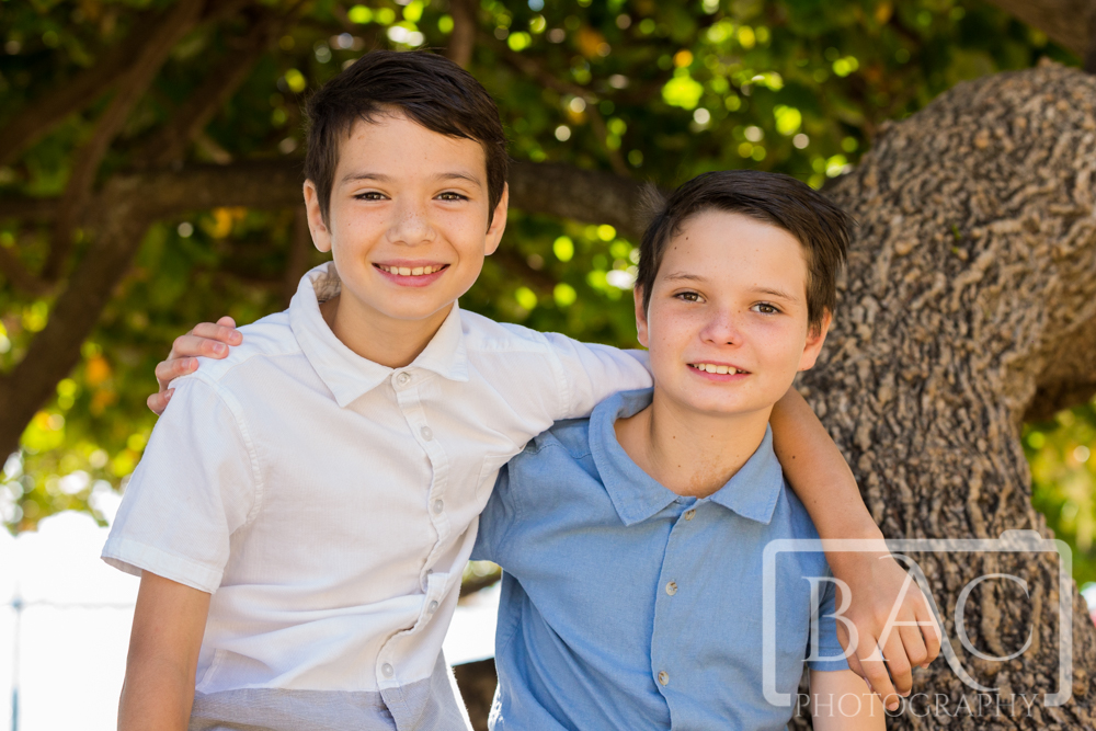 brothers portrait in the trees