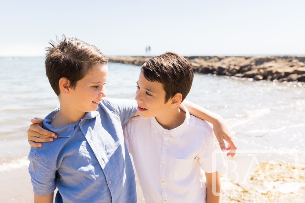 brothers love portrait on the beach