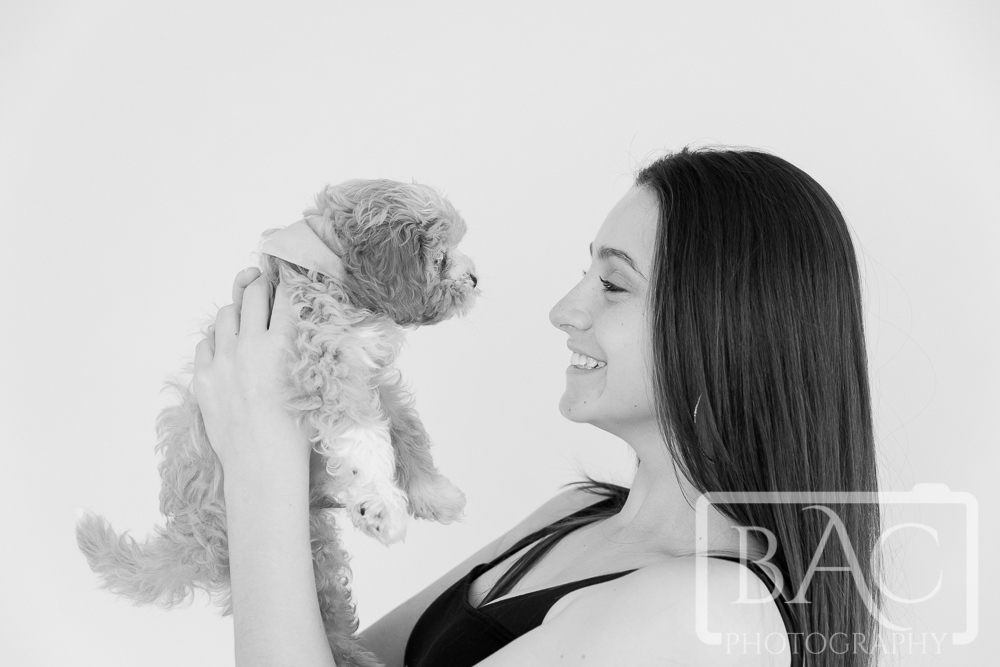 girl with cavoodle puppy portrait in studio