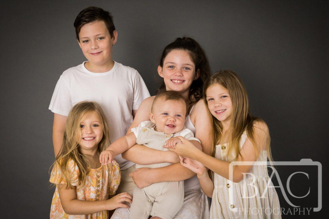 cousins studio portrait 5 kids